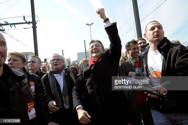 French Front de Gauche candidate for the 2012 French presidential election JeanLuc Melenchon raises his fist as he arrives for a meeting with an...