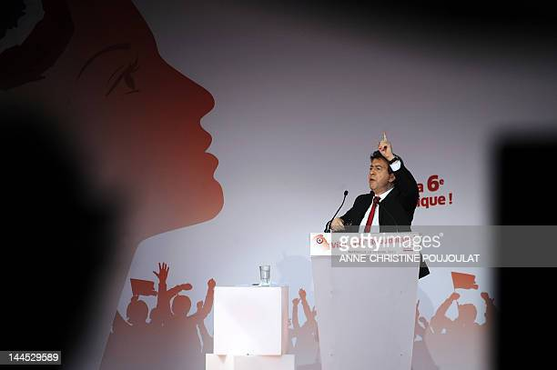 French Front de Gauche leftist party's candidate for the 2012 French presidential election JeanLuc Melenchon gives a speech during a campaign meeting...