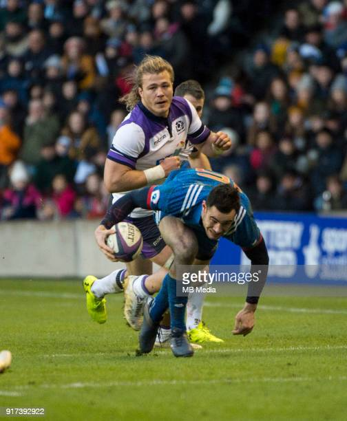French full back Geoffrey Palis gets away from David Denton at Murrayfield on February 11 2018 in Edinburgh Scotland