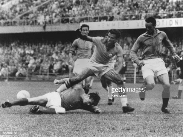 A French fullback throws himself at the feet of Brazilian forward Vava during the World Cup semifinal at the Rasunda Stadion in Solna Stockholm 24th...
