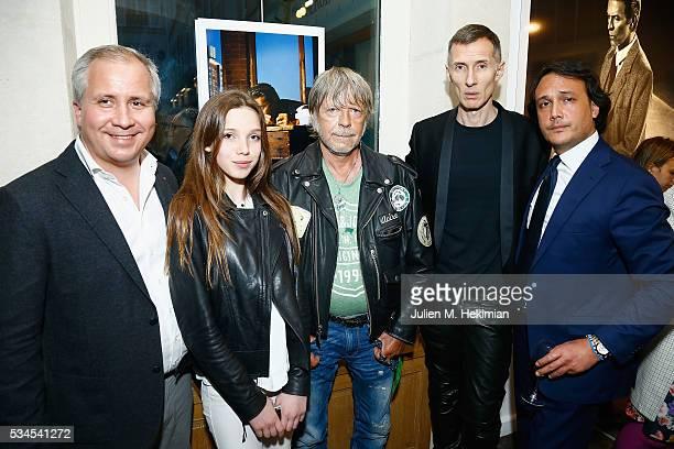 French Galerist Jonathan Gervoson his daughter Gabrielle French Singer Renaud Photographer Markus Klinko and David Swaelens Kane attend the David...