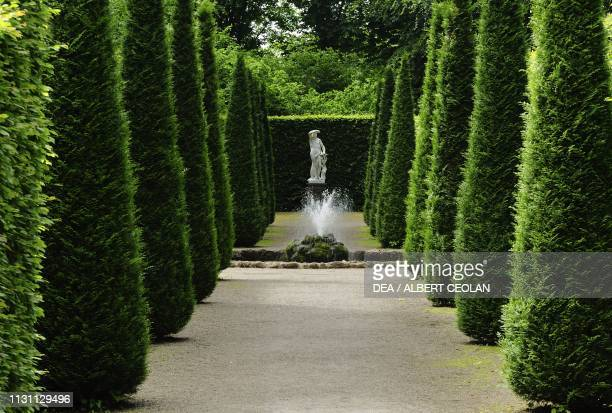French garden with statue in the background Schwetzingen Castle BadenWurttemberg Germany