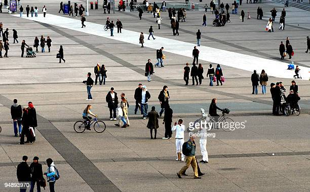 French gather at dusk on the esplanade of the Arche de la Defense in eastern Paris France on Saturday Feb 23 2008 While Europe's thirdlargest economy...