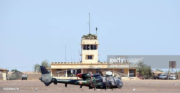 A French Gazelle helicopter sits in front of the main terminal at the airport in Gao on March 9 where the French forces have established one of their...