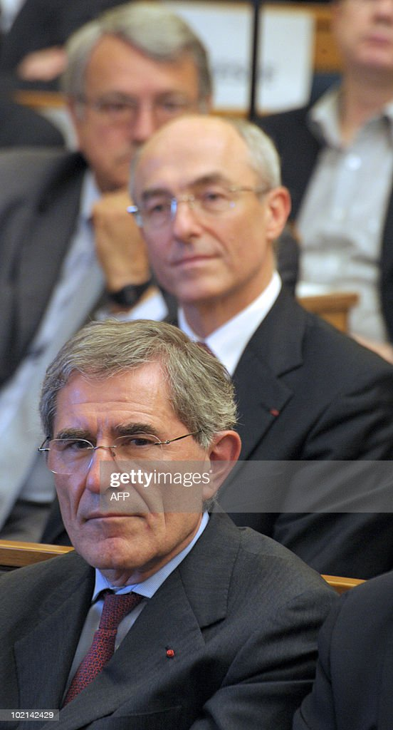 French GDF SUEZ Chairman and Chief Executive Officer, Gerard Mestrallet in front of French Chairman and CEO of Air Liquide, Benoit Potier, listens to a speaker on June 16, 2010 at the National Assembly in Paris during a symposium about French CAC 40 companies.