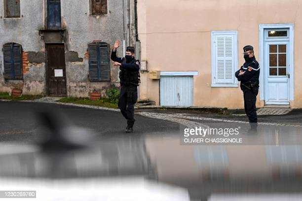 French Gendarme gestures in a street Saint-Just, central France on December 23 after three gendarmes were killed and a fourth wounded by a gunman...
