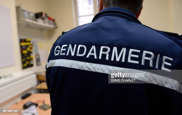 A French gendarme of the BDRIJ unit specialized in new technologies works on January 9 2014 in Arras northern France Since 2002 French gendarmerie's...