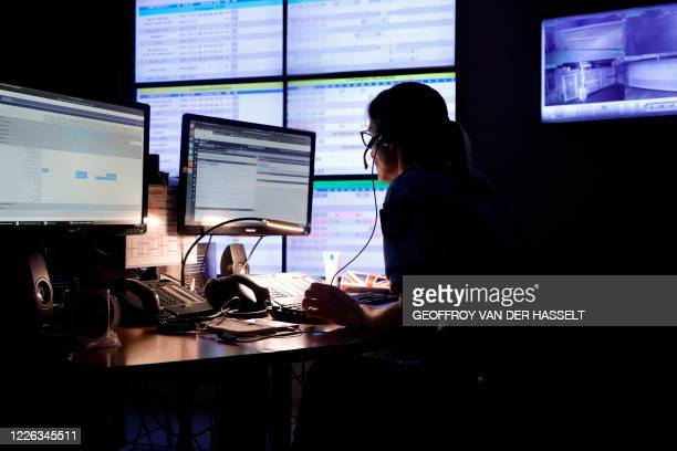 French gendarme officer answers emergency phone calls in the CORG, Centre d Operations et de Renseignement of the Gendarmerie, in Evry-Courcouronnes,...