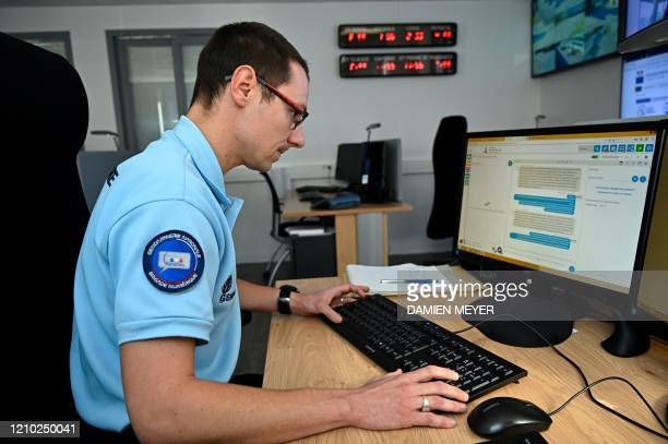"""French gendarme replies to an internet user at the """"Brigade Numerique """" headquarters in Rennes, western France, on April 10, 2020 on the 25th day of..."""