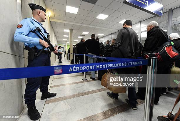 A French Gendarme stands guard at the airport of Montpellier southern France as passengers go through boarding on November 20 2015 The European Union...