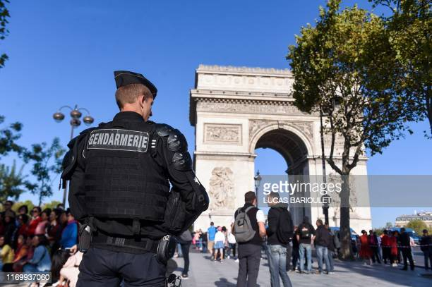 """French gendarme stands guard in front of the Arc de Triomphe before an anti-government demonstration called by the """"yellow vest"""" movement, on..."""