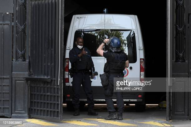 A French Gendarme stands guard next to a prison van transporting Felicien Kabuga one of the last key fugitives wanted over the 1994 Rwandan genocide...