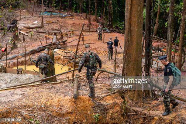 French gendarmes and members of the World Wildlife Fund arrive on an illegal gold panning site near the village of Cacao 60 kms from the capital...