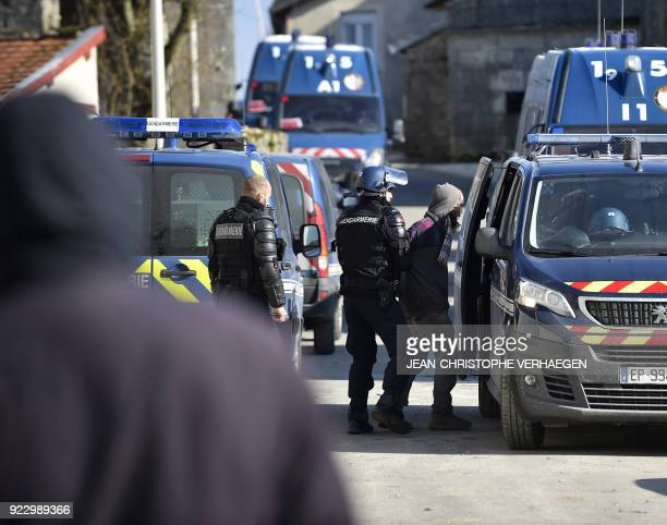 French gendarmes arrest a member of the 'House of Resistance against Nuclear Waste' in Bure northeastern France on February 22 2018 French gendarmes...