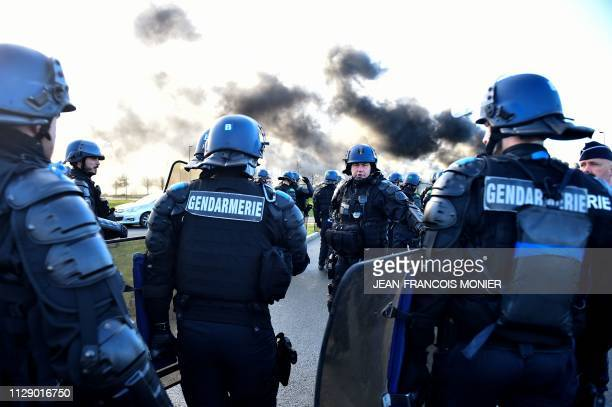 TOPSHOT French gendarmes arrive for evacuation as prison guards block the entrance to the penitentiary center of Alencon in CondesurSarthe...