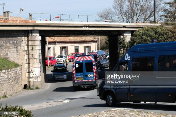 French gendarmes block the access to Trebes a small town in southern France where a man took hostages at a supermarket on March 23 2018 Security...
