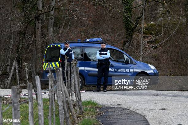 French gendarmes block the Col de Marocaz pass near Cruet on March 29 2018 as Nordahl Lelandais who is suspected of having murdered French soldier...
