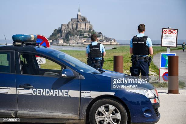 French gendarmes block the road leading to the MontSaintMichel after it was evacuated on April 22 2018 of its tourists and residents as a precautious...