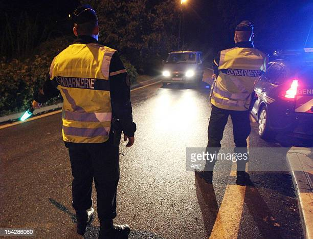 French gendarmes check cars in the area one of their colleague was run over by a car and died on October 17 2012 in La Grave de Peille southeastern...