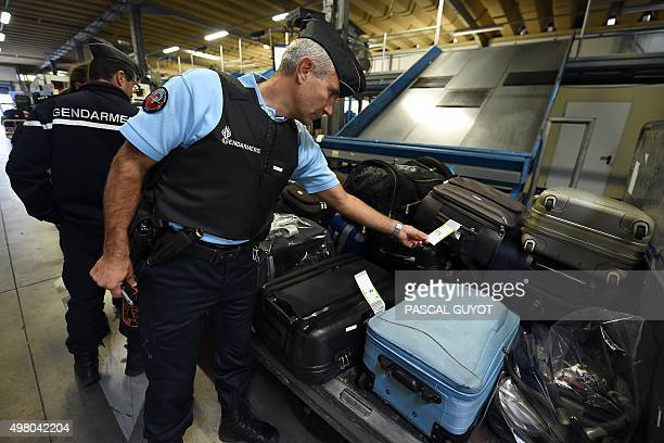 French Gendarmes control bags at the airport of Montpellier southern France on November 20 2015 The European Union agreed on November 20 to rush...