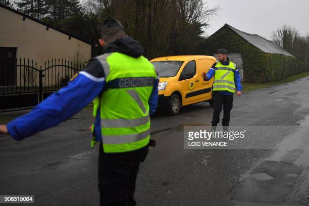 French gendarmes control cars in front of the city hall of NotreDamedesLandes outside Nantes on January 18 2018 a day after French Prime minister...