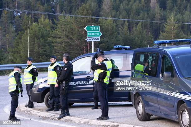 French gendarmes control the entrance to the valley of Nevache on April 23 2018 near Briancon southeastern France a route leading to the Col de...