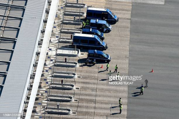 French Gendarmes control vehicles at the toll of Virsac, southwestern France, on April 4 on the nineteenth day of a lockdown in France aimed at...