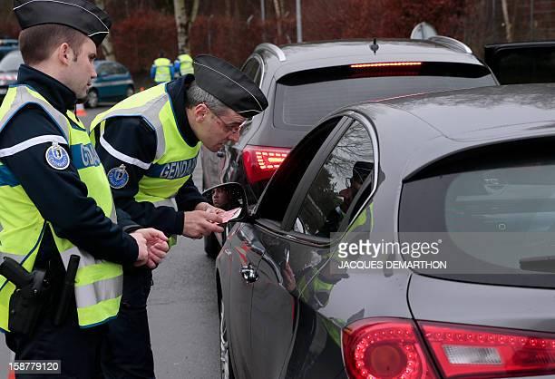 French gendarmes control vehicles on December 28 2012 at the FleuryenBière's toll AFP PHOTO/JACQUES DEMARTHON