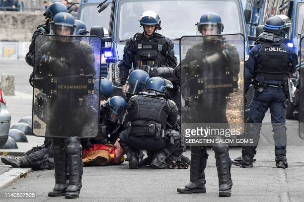 French gendarmes detain a demonstrator during the traditional May Day rally in Nantes, western France, on May 1, 2019.