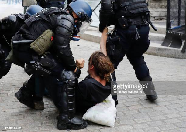 French Gendarmes detain a man during a demonstration in the city of Bayonne southwest France on August 24 on the sidelines of the annual G7 Summit...