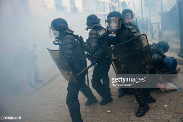 French Gendarmes detain a man during an anti-G7 summit demonstration, as world leaders gather for the G7 summit in the nearby seaside resort of...