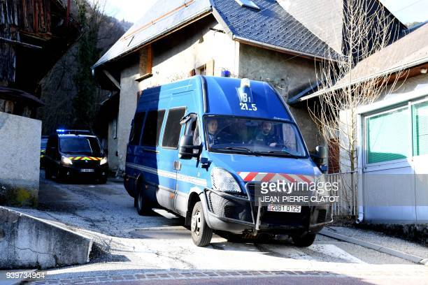 French gendarmes drive away after blocking the Col de Marocaz pass near Cruet on March 29 2018 as Nordahl Lelandais who is suspected of having...