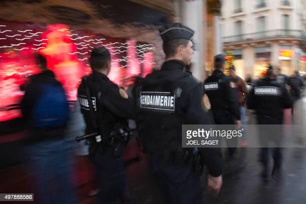 French gendarmes enforcing the Vigipirate plan France's national security alert system patrol on November 19 2015 in Paris France revealed on...