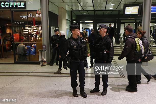 French gendarmes enforcing the Vigipirate plan France's national security alert system patrol on November 19 2015 in a railway station Paris France...