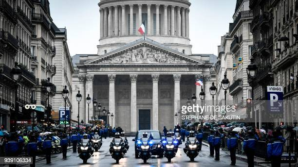 TOPSHOT French gendarmes escort the coffin of the late Lieutenant Colonel Arnaud Beltrame transported by car during a funeral procession leaving the...