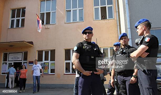 French gendarmes of the Eulex the European Union Rule of Law Mission in Kosovo stand in front of a polling station in the north of the ethnically...