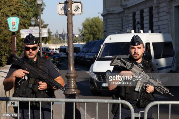 French Gendarmes officers stand guard outside the Palais de Justice of Paris - Paris' courthouse, on September 8 ahead of the start of the trial of...