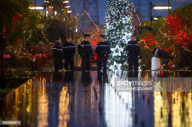 TOPSHOT French Gendarmes patrol at the Christmas market in Tours central France on December 23 2016 Security was beefed up at Christmas markets...