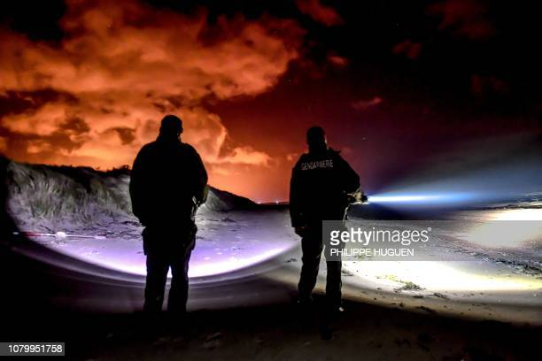 French gendarmes patrol on the beach of Oye-Plage, near Calais, northern France, on January 9, 2019 as they try to intercept migrants attempting to...