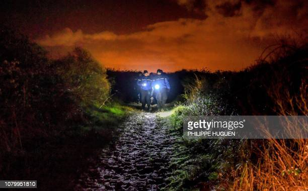 French gendarmes patrol on the beach of OyePlage near Calais northern France on January 9 2019 as they try to intercept migrants attempting to cross...