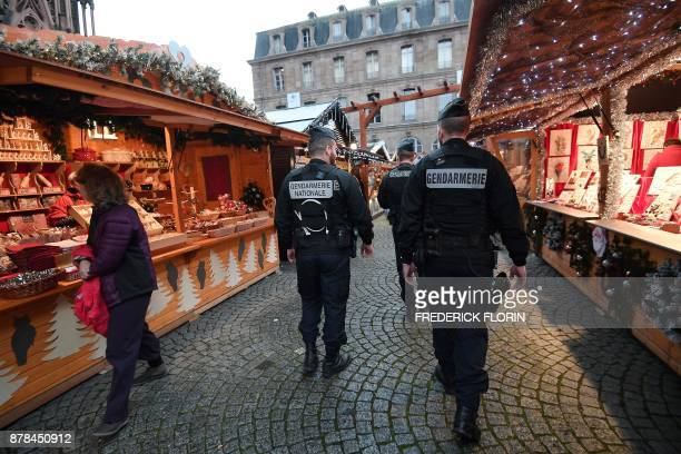 French gendarmes patrol on the opening day of the Christmas market in Strasbourg eastern France on November 24 2017 / AFP PHOTO / FREDERICK FLORIN