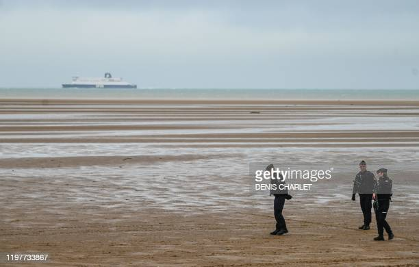 French gendarmes patrol the beach in Oye-Plage, near Calais, northern France, as part of a monitoring mission of beaches from which migrants attempt...