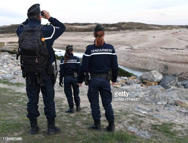 French Gendarmes patrol the beaches at Tardinghen near the northern port city of Calais on April 4, 2019. - Since the end of October 2018, the French...