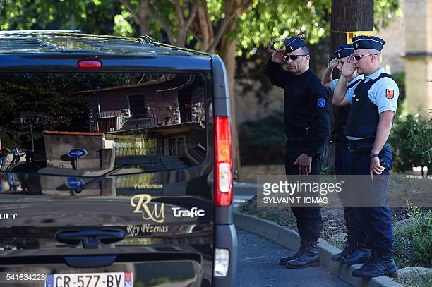French Gendarmes salute the funeral convoy carrying French policeman JeanBaptiste Salvaing and his partner Jessica Schneider who were killed outside...