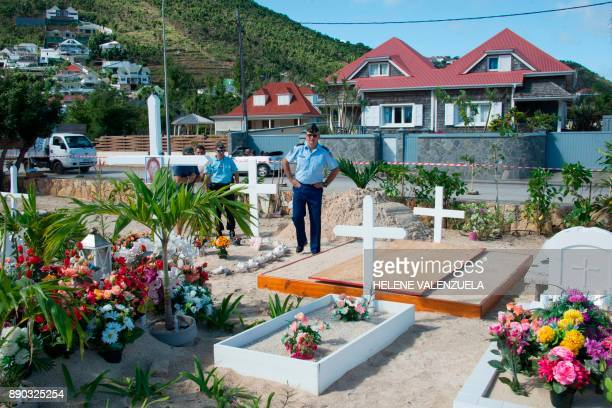 TOPSHOT French gendarmes stand by as final preparations are made on December 11 2017 at the cemetery in Lorient on the French Caribbean island of...