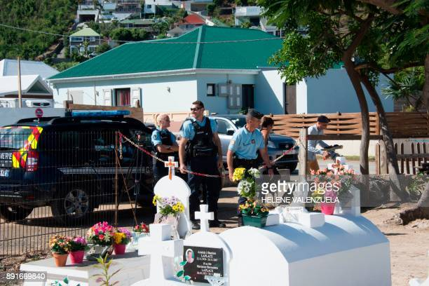 French gendarmes stand by as final preparations are made on December 11 2017 at the cemetery in Lorient on the French Caribbean island of Saint...