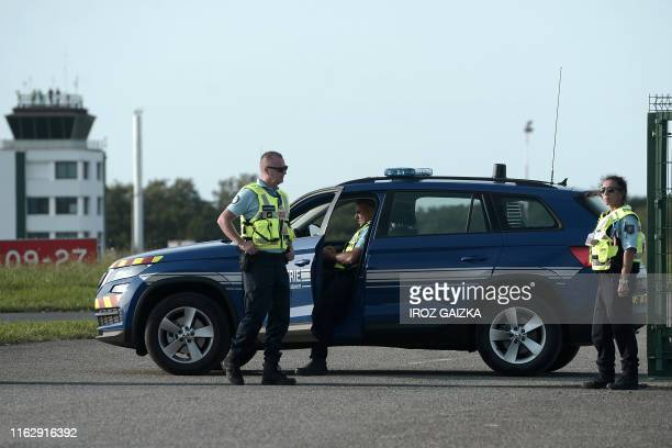 French gendarmes stand guard at the Parme airport of Biarritz on August 20, 2019 ahead of the 45th Group of Seven nations annual summit which will...