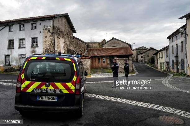 French Gendarmes stand guard in a street Saint-Just, central France on December 23 after three gendarmes were killed and a fourth wounded by a gunman...
