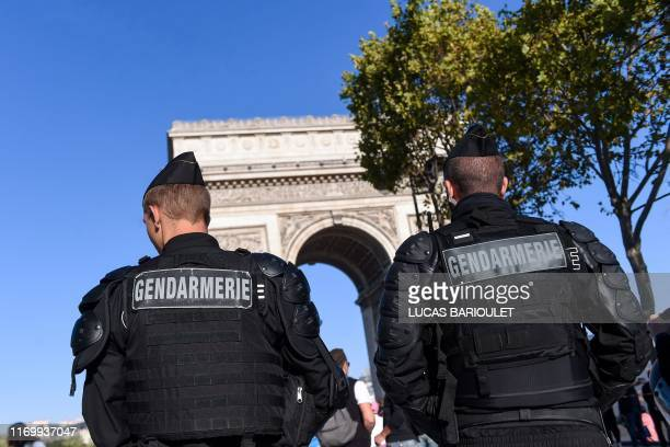 """French gendarmes stand guard in front of the Arc de Triomphe before an anti-government demonstration called by the """"yellow vest"""" movement, on..."""