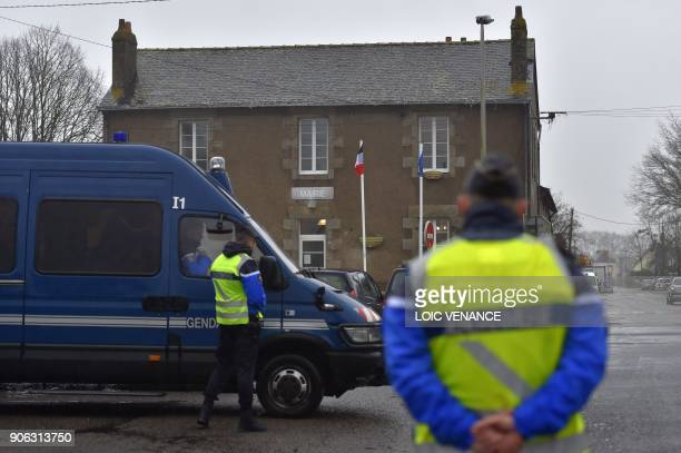 French gendarmes stand guard in front of the city hall of NotreDamedesLandes outside Nantes on January 18 2018 a day after French Prime minister...
